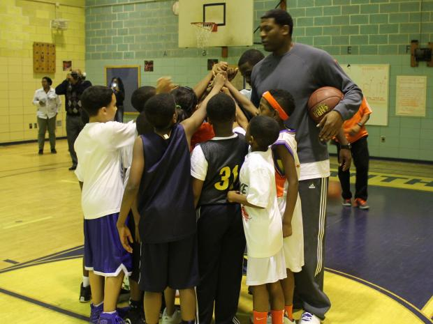 Former New York Knick Larry Johnson visited a school in Jamaica, Queens, on February 28, 2013.