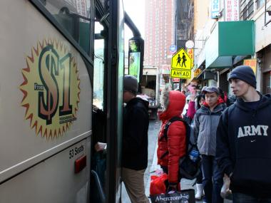 Passengers board a low-cost Chinatown bus. City, state and federal authorities have been cracking down on safety violations in the industry.
