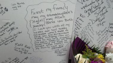 German Martinez writes a note to his granddaughters, Hazel and Hailey Martinez, after a fatal fire at their Bronx building on March 17, 2013.
