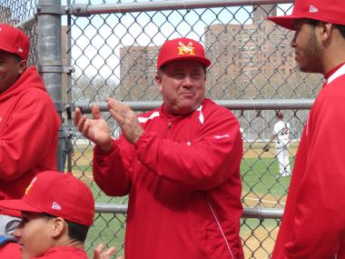 Monroe baseball coach Mike Turo addresses his team following a win over Cardozo on March 27, 2013