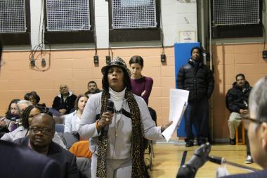 A group of angry and skeptical residents and activists questioned the New York City Housing Authority's plan to build market-rate housing on the campus of Washington Houses in East Harlem Thursday night during a sometimes raucous meeting.