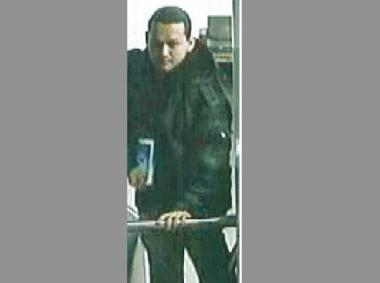 Police are looking for this man, who allegedly stole an iPad from a woman on the Q train on March 15, 2013.