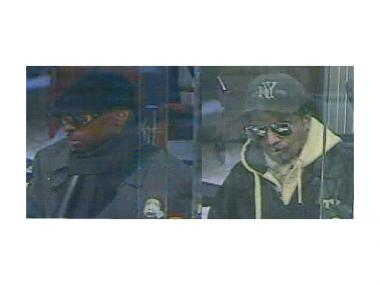 Police are looking for these two men in connection with a robbery at NorthEast Community Bank at 1751 Second Ave. on Feb. 26, 2013.