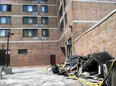 Residents of a South Bronx building were still complaining Sunday of black soot in their apartments and searching for an explanation for the three-alarm fire that broke out Saturday morning and left at least 32 people injured, five of them critically.