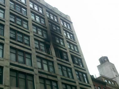 The blaze erupted on the fifth floor of The Petersfield, at 115 Fourth Ave., about midnight, killing an 84-year-old woman inside.