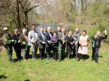 Officials cut the ribbon on the first section of Goodhue Park in New Brighton.
