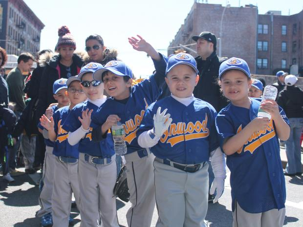 More than 450 children marched up Broadway on a clear Saturday to begin the league's 63rd season.