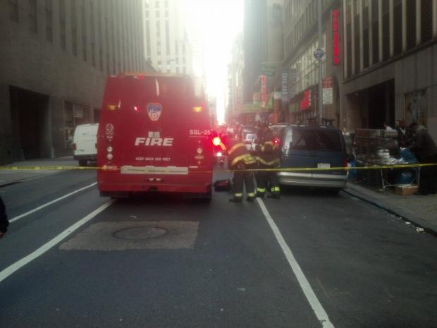 Two people were hospitalized when two vehicles ran onto a sidewalk and hit scaffolding in Manhattan.