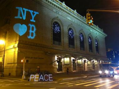The Illuminator, a political art group that was formed by Occupy Wall Street supporters, lights up Fort Greene with a message of support for Boston.