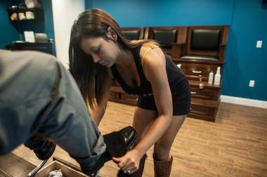 Scantiliy clad ladies offer shoe shines at Star Shine NYC in FiDi.