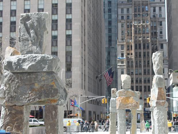 Mayor Bloomberg unveiled an exhibit in Rockefeller Center on Monday featuring nine human-shaped stone figures.