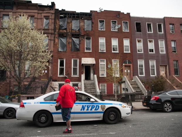 Two firefighters and one civilian were injured in the blaze early Monday morning, the FDNY said.