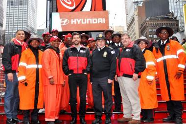Members of the Times Square Alliance, including president Tim Tompkins, fourth from left, and senior vice president for operations Tom Harris, third from right, paused for a photo amid their response efforts following Hurricane Sandy in the fall of 2012.