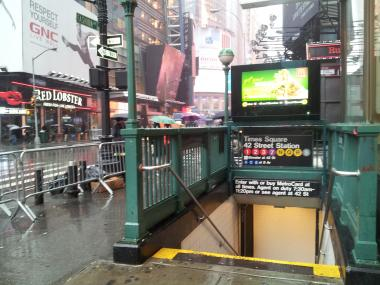 A man died after falling into the trackbed of the Times Square subway station, FDNY said.