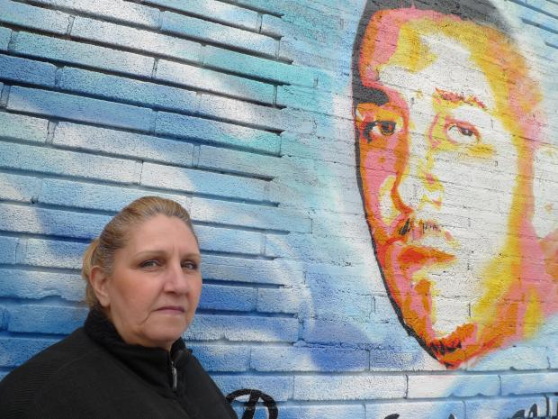 A mural painted in memory of a young man shot years ago got a make-over recently.
