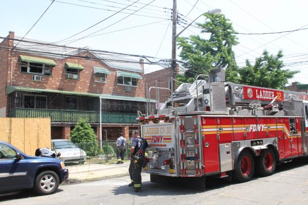 The fire broke out in a three-story home at 823 E. 219th St. Friday morning, the FDNY said.