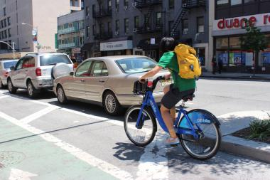 A Citi Bike rider uses the Eighth Avenue cycling path.