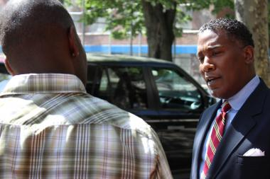 City Council candidate Conrad Tillard stops to chat on Lewis Avenue in Bed-Stuy.