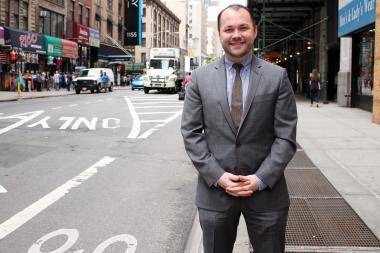 City Councilman Corey Johnson tried to call police officials while being given a ticket for moving between subway cars, NYPD Commissioner Bill Bratton said during a press conference Friday.