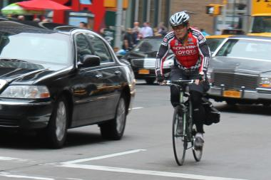 A bicyclist rides up Sixth Avenue in Midtown in April 2013. Under new legislation Brooklyn Councilman Mark Treyger plans to introduce Thursday, New York City would ban bicyclists from using their cellphones while riding.