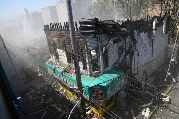 A massive fire erupted at 3985 White Plains Rd. Thursday morning and disrupted train service in the area for hours.
