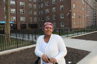 "Other residents like Ieshia Gilchrist, 28, a homemaker whose 6 and 9 year-old sons go to HCZ afterschool programs, said they were happy to live near the school. ""A lot of people were protesting but I'm glad they built it for the kids,"" said Gilchrist. ""Now that it's up, it looks good."""
