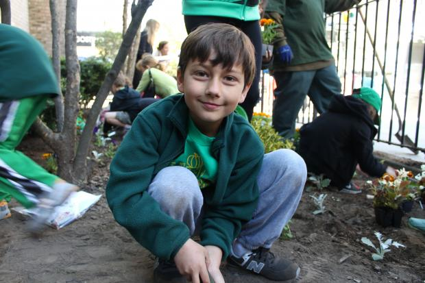 Forty students joined formerly homeless individuals to create a garden to brighten Goddard Rierside.