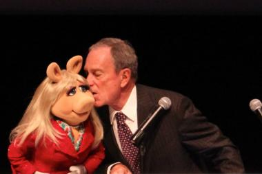 Mayor Michael Bloomberg plants a smooch on Miss Piggy at the Museum of the Moving Image in Queens on May 21, 2013.