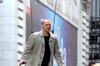 "Michael Keaton dangles from a crane in Times Square Sunday, May 26, 2013, during a shoot for his 2014 movie, ""Birdman,"" directed by Alejandro Gonzalez Inarritu."