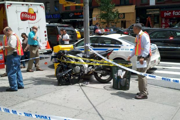 A 20-year-old man was hospitalized Wednesday after hitting a bus while driving a motorcycle in Manhattan, cops said.