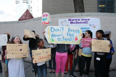 Some of the students who gathered to protest the DOE's plan on Friday morning.
