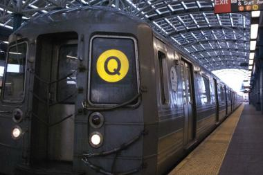 Two men tried to rob a passenger on a Q train Tuesday, police said.
