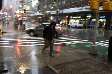 A man treks through the rain in Manhattan Wednesday morning.