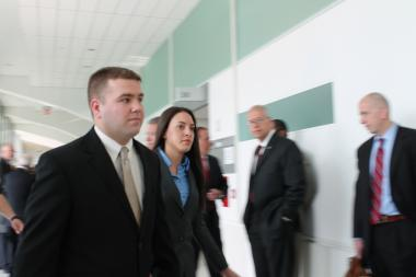 NYPD Officer Richard Haste enters a courtroom in the Bronx on Tuesday, May 15, 2013 where a judge dismissed the manslaughter indictment against him for shooting and killing an unarmed Ramarley Graham in his home on Feb. 2, 2012.
