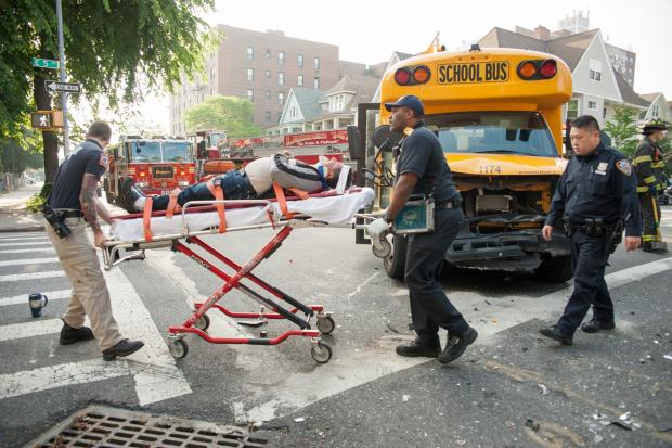 A school bus and white sedan collided at the intersection of East 5th Street and Avenue C in Brooklyn.