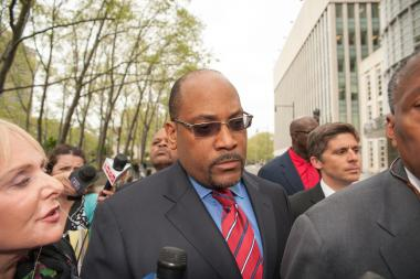 Sen. John Sampson leaves the Brooklyn Federal Courthouse on Monday May 6, 2013. Sampson was indicted twice by feds, and faces a primary from multiple challengers.