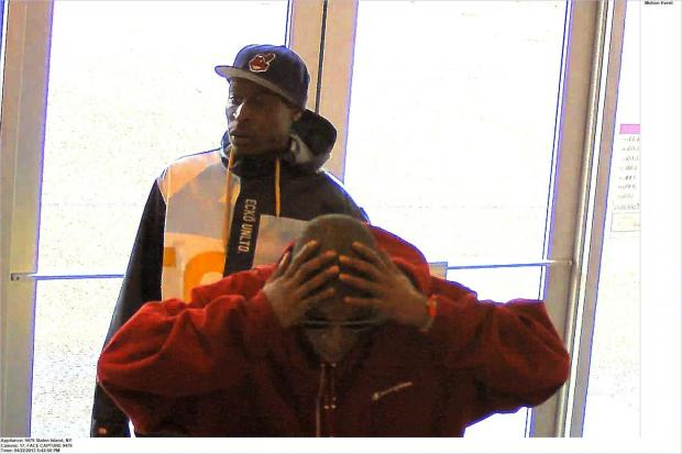 Police are looking for these two men, who allegedly stole displayed iPhones from two Staten Island T-Mobile stores in April, 2013.