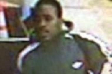 Police are looking for this man who they say grabbed a woman's purse and ran off last month.