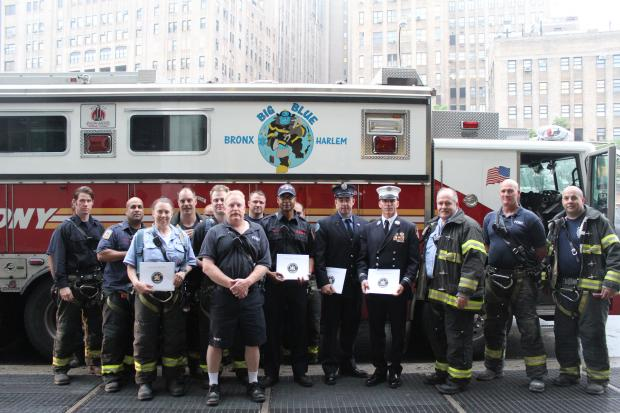 The firefighters were honored for saving two children stranded high on the rocks in Fort Tryon Park.