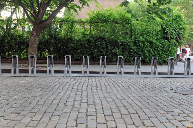 A bike-share station at Barrow and Hudson streets was moved across the street after complaints.