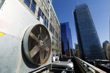 A large, industrial air conditioner, perched atop a Midtown skyscraper.