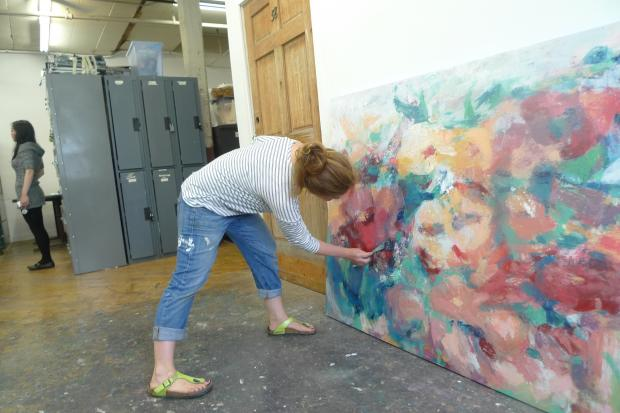A painter at work in 2013 in one of the semi-private artist studios at 168 Seventh St. The nonprofit arts group Trestle Art Space is leaving the building but has opened new studios in Sunset Park.