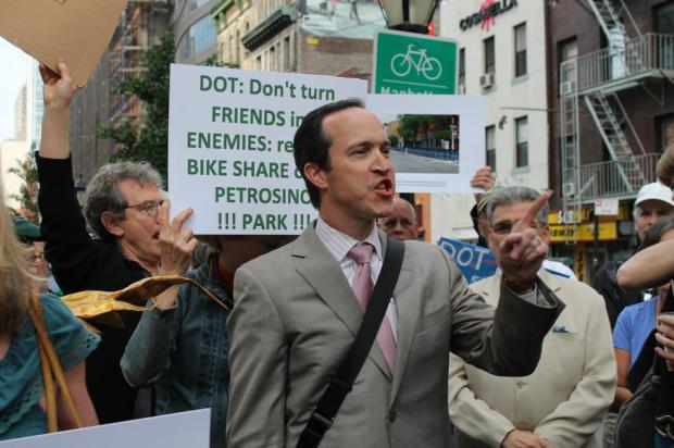 A group of SoHo residents is suing the city over its refusal to move a Citi Bike station.