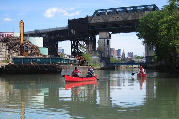 Canoers on the heavily polluted Gowanus Canal, near where developer Property Markets Group is spending about $50 million to buy property on the canal.