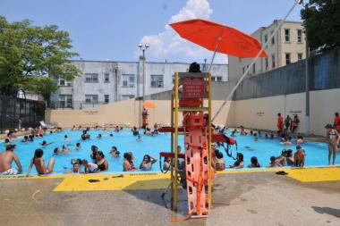 Cool off at one of the city's public pools, like Fisher Pool in East Elmhurst.