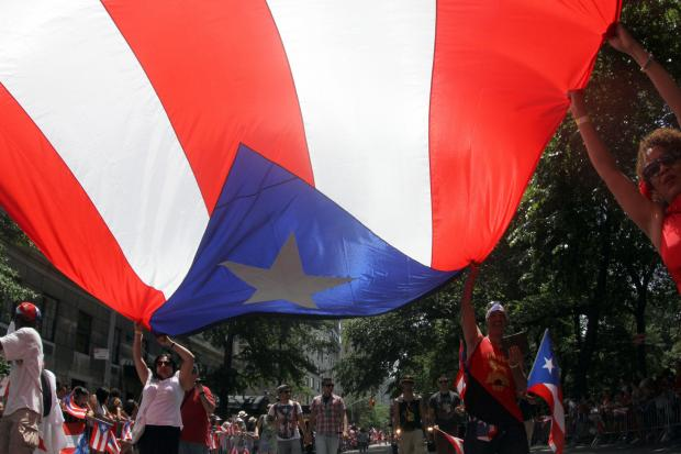 Carrying a huge flag at the 56th annual National Puerto Rican Day Parade on Fifth Avenue June 9, 2013.