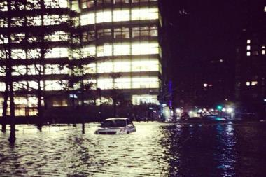The streets surrounding the Goldman Sachs Building in the Financial District were flooded by Hurricane Sandy. A cleaner at the building claims he was fired in the wake of the storm and forced to wade through the chest-high waters.