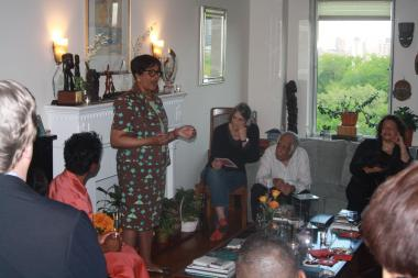 Joyce Johnson talking to supporters at a house party.