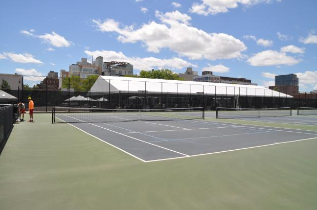 The tennis courts at McCarren Park will be covered by a heated bubble starting October 2014.