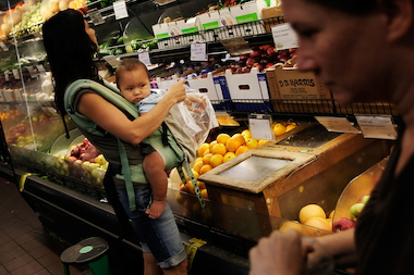 Shoppers at the Park Slope Food Coop. A central Brooklyn food cooperative has voted to adopt the Park Slope institution's co-op model.
